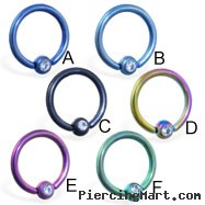 Colored steel/titanium anodized captive bead ring with clear gem, 16 ga