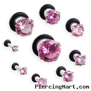 Pair Of Stainless Steel Hollow Plugs with Large Pink Gem